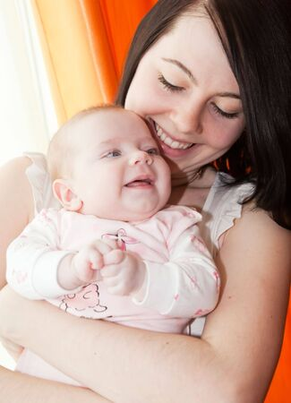 Adorable baby and mother in home photo