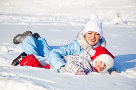 Mother and daughter playing in the snow Stock Photo - 6462663