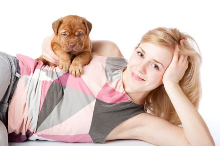 mastiff: Young girl with puply of Dogue de Bordeaux (French mastiff). Isolated on white background Stock Photo