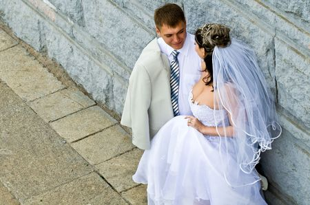 Bride in white dress and bridegroom photo