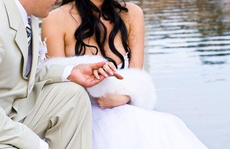 Bride in white dress and bridegroom photo