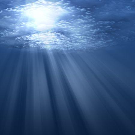 dazzle: Underwater scene with sun rays shining through water surface.