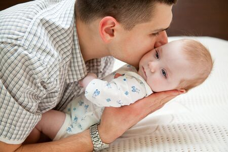 laughing baby: Adorable baby and father in home Stock Photo