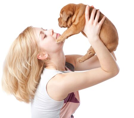 dogue de bordeaux: Young girl with puppy of Dogue de Bordeaux (French mastiff). Isolated on white background