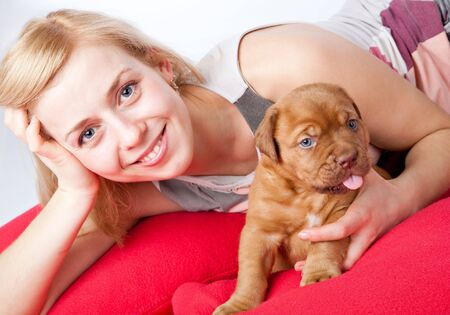 Young girl with puppy of Dogue de Bordeaux (French mastiff). Isolated on white background photo