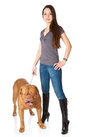 french mastiff: Young girl with  Dogue de Bordeaux (French mastiff). Isolated on white background Stock Photo