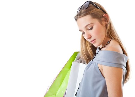 Happy girl with shopping bags. Isolated on a white background photo