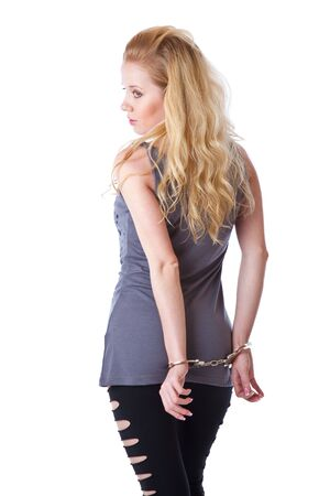 Blond woman with handcuffs. Isolated on white background Stock Photo - 6790009