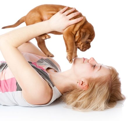 french mastiff: Young girl with puppy of Dogue de Bordeaux (French mastiff). Isolated on white background