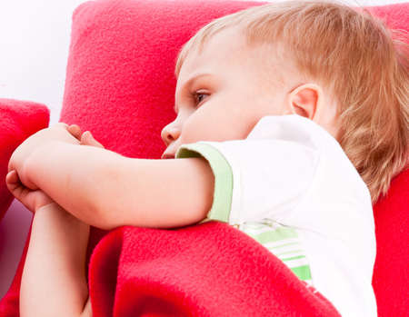 Little boy is sleeping on a red pillow Stock Photo - 6790041