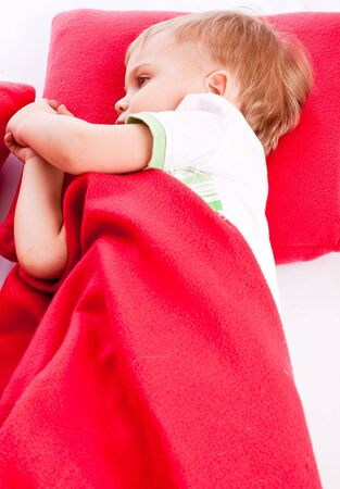 Little boy is sleeping on a red pillow Stock Photo - 6865968