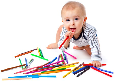 Baby with pencils. Isolated on white background photo
