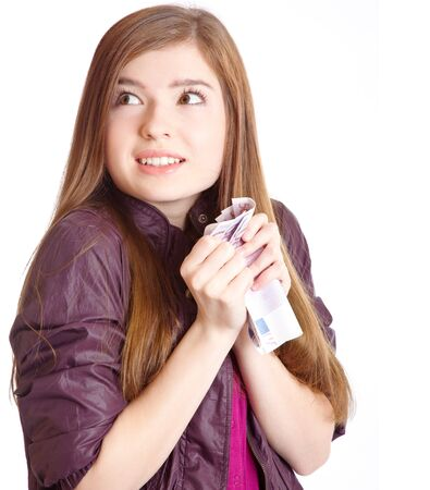 Girl with money in hands. Isolated on white background photo
