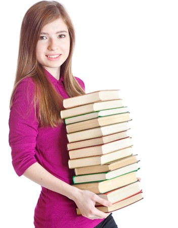 Young girl with pil� of books in hands. Isolated on white background photo