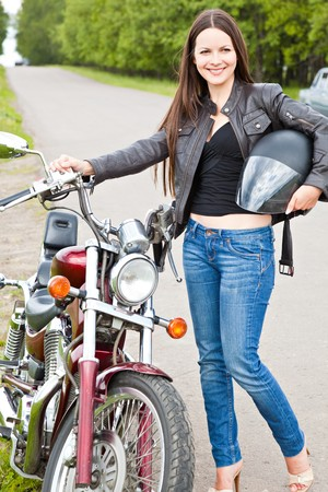 Young biker girl on a motorcycle photo