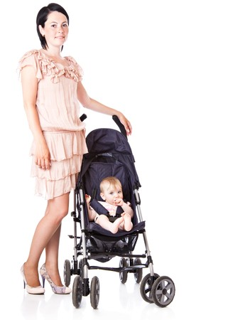 carriages: Young mother with baby in perambulator. Isolated on white background