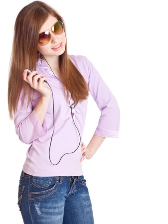 portable mp3 player: Young girl listening to music om mp3 player. Isolated on white background