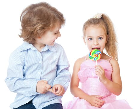 Boy and girl with lollipops. Isolated on white background Stock Photo - 7218645
