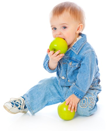 Baby with green apple. Isolated on white background photo