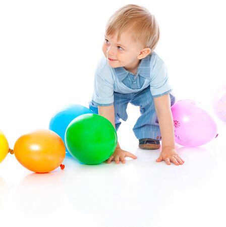 Little baby in balloons. Isolated on white background photo