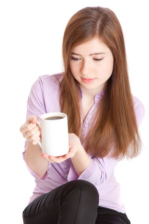 Young girl with mug with coffee. Isolated on white background photo