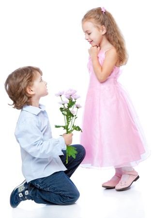 junior: Little boy and girl in love. Isolated on white background