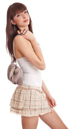 Beautiful teenage girl. Isolated on white background photo