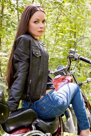 woman motorcycle: Young biker girl on a motorcycle