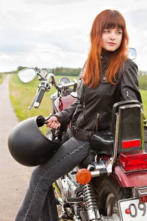 outside machines: Young biker girl on a motorcycle