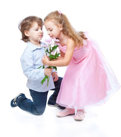 amused: Little boy and girl in love. Isolated on white background