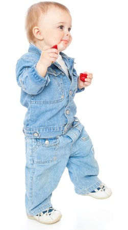 Boy with strawberry. Isolated on white background photo