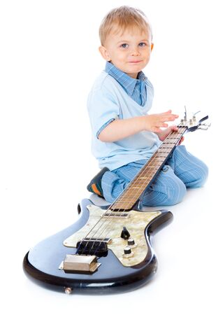 Little boy with guitar. Isolated on white photo