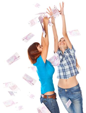 Banknotes of 500 euro are falling on two girls. Isolated on white background Stock Photo - 8005319