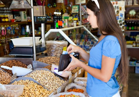 Woman is buying in food-shop Stock Photo - 8005325