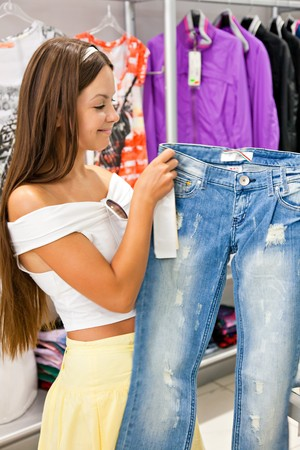 Woman is buying jeans in shop Stock Photo - 8005313