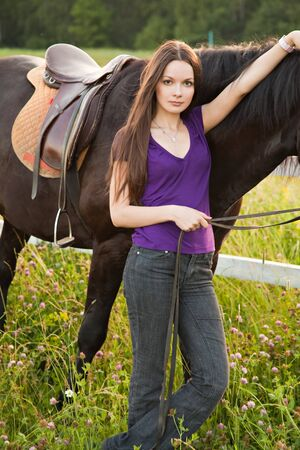 The young woman with a horse photo