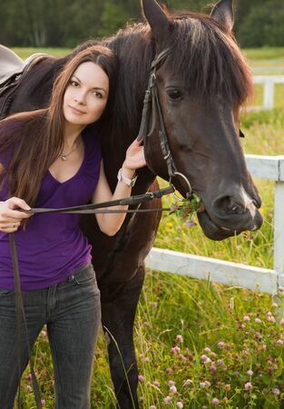 cute young farm girl: The young woman with a horse