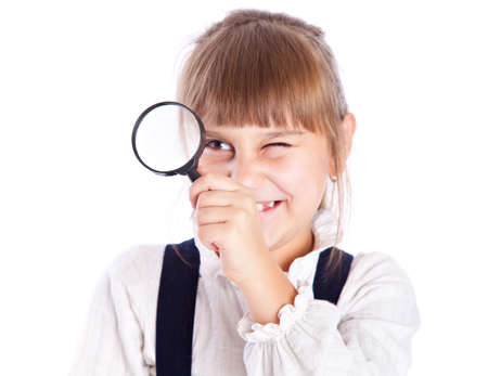 Little girl with loupe. Isolated on whie background photo