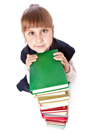 able: Schoolgirl with books is looking up. Isolated on white background