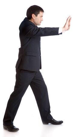 Businessman is pushing something. Isolated on white