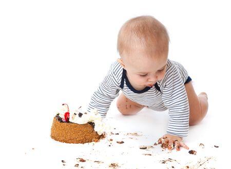 Baby and cake. Isolated on white background photo