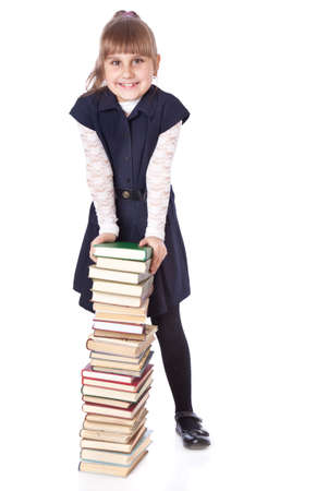 able to learn: Schoolgirl witn books. Isolated on white background