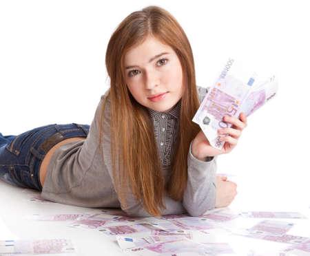 Girl with money. Isolated on white background photo