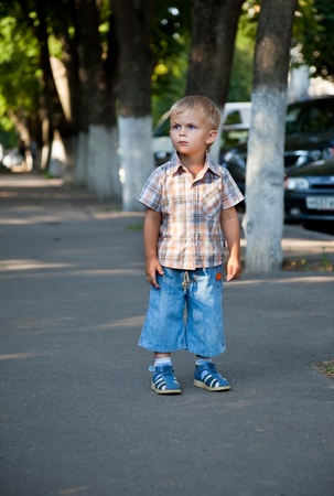 a contracted little boy lost in the street photo