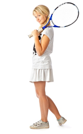Young teenage girl holding a tennis racket. Isolated on white background photo