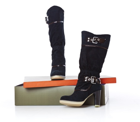 high boots on a box. isolated on a white background photo