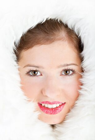 Beautiful winter girl is in the furs. Face is closeup photo