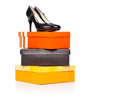 fashion shoes on the boxes. isolated on a white background photo