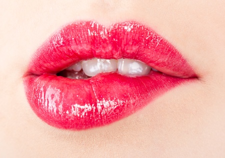 sexual pleasure: A beautiful girl`s lips (close-up) Stock Photo