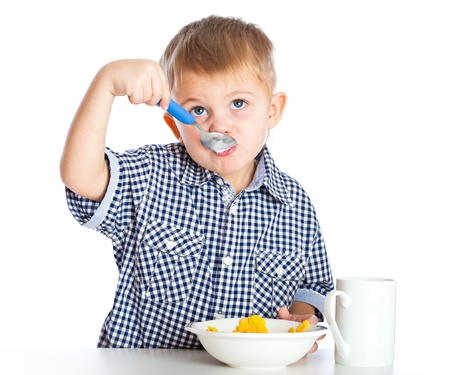 cereal bowl: A boy is eating cereal from a bowl. Isolated on a white background